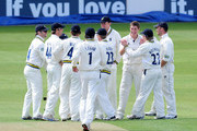 Chris Woakes of Warwickshire celebrates with team-mates after taking the wicket of Nic Pothas of Hampshire during the LV County Championship match between Warwickshire and Hampshire at Edgbaston on April 30, 2010 in Birmingham, England.