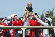 WaWASHINGTON, DC - JUNE 12:  Alex Ovechkin and Nicklas Backstrom of the NHL champions Washington Capitals hold up Backstrom's son on the Stanley Cup during a victory parade along Contitution Avenue June 12, 2018, in Washington, DC.