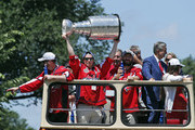 Nicklas Backstrom of the NHL Stanley Cup champion Washington Capitals holds up the Stanley Cup during a victory parade on June 12, 2018 in Washington, DC.