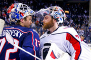 Sergei Bobrovsky #72 of the Columbus Blue Jackets congratulates Braden Holtby #70 of the Washington Capitals at the end of Game Six of the Eastern Conference First Round during the 2018 NHL Stanley Cup Playoffs on April 23, 2018 at Nationwide Arena in Columbus, Ohio. Washington defeated Columbus 6-3 to win the series 4-2.