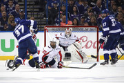 Yanni Gourde #37 of the Tampa Bay Lightning shoots the puck against Braden Holtby #70 of the Washington Capitals during the first period in Game One of the Eastern Conference Finals during the 2018 NHL Stanley Cup Playoffs at Amalie Arena on May 11, 2018 in Tampa, Florida.