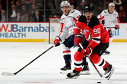 Marcus Johansson #90 of the New Jersey Devils takes the puck as Lars Eller #20 of the Washington Capitals defends on January 18, 2018 at Prudential Center in Newark, New Jersey.