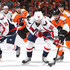 Marcus Johansson Photos - Marcus Johansson #90 of the Washington Capitals skates with the puck past Mark Streit #32 of the Philadelphia Flyers in the first period at Wells Fargo Center on November 12, 2015 in Philadelphia, Pennsylvania. - Washington Capitals v Philadelphia Flyers
