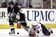 Brooks Orpik #44 of the Pittsburgh Penguins battles for a loose puck with Alex Ovechkin #8 of the Washington Capitals in the second period at Mellon Arena on April 6, 2009 in Pittsburgh, Pennsylvania.