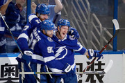 Ondrej Palat #18 of the Tampa Bay Lightning celebrates with his teammates Victor Hedman #77 and Steven Stamkos #91 after scoring a goal on Braden Holtby #70 of the Washington Capitals during the first period in Game Five of the Eastern Conference Finals during the 2018 NHL Stanley Cup Playoffs at Amalie Arena on May 19, 2018 in Tampa, Florida.