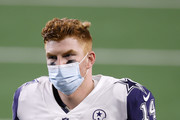 Andy Dalton #14 of the Dallas Cowboys heads off the field after losing to the Washington Football Team 41-16 at AT&T Stadium on November 26, 2020 in Arlington, Texas.