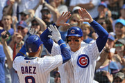 Javier Baez #9 and Anthony Rizzo #44 of the Chicago Cubs celebrate after scoring runs in the 6th inning against the Washington Nationals at Wrigley Field on August 10, 2018 in Chicago, Illinois.