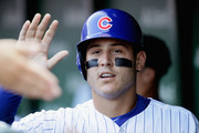 Anthony Rizzo #44 of the Chicago Cubs is congratulated in the dugout after collecting the 1,000th hit of his career, a single in the 3rd inning, against the Washington Nationals at Wrigley Field on August 11, 2018 in Chicago, Illinois.