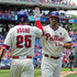 Jeff Francoeur Photos - Jeff Francoeur #3 of the Philadelphia Phillies high fives Cody Asche #25 after hitting a solo home run in the second inning during game one of a doubleheader against the Washington Nationals at Citizens Bank Park on June 28, 2015 in Philadelphia, Pennsylvania. - Washington Nationals v Philadelphia Phillies - Game One