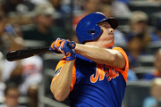 Jay Bruce #19 of the New York Mets hits a two-run home run against the Washington Nationals during the eighth inning of a game at Citi Field on August 24, 2018 in the Flushing neighborhood of the Queens borough of New York City.  All players across MLB will wear nicknames on their backs as well as colorful, non-traditional uniforms featuring alternate designs inspired by youth-league uniforms.