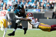 Jerricho Cotchery #82 of the Carolina Panthers makes a catch against Kyshoen Jarrett #30 of the Washington Redskins in the 1st half during their game at Bank of America Stadium on November 22, 2015 in Charlotte, North Carolina.