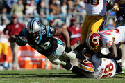 Jonathan Stewart #28 of the Carolina Panthers runs the ball against Kyshoen Jarrett #30 and Dashon Goldson #38 of the Washington Redskins in the 2nd quarter during their game at Bank of America Stadium on November 22, 2015 in Charlotte, North Carolina.