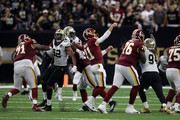 Marcus Davenport #92 of the New Orleans Saints strips the ball as Alex Smith #11 of the Washington Redskins throws during the second halfat Mercedes-Benz Superdome on October 8, 2018 in New Orleans, Louisiana.