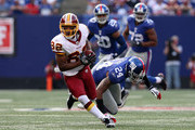 Antwaan Randle El #82 of the Washington Redskins runs a reception past Terrell Thomas #24 of the New York Giants on September 13, 2009 at Giants Stadium in East Rutherford, New Jersey.