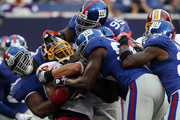 Clinton Portis #26 of the Washington Redskins is tackled against the New York Giants on September 13, 2009 at Giants Stadium in East Rutherford, New Jersey.