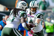 Chris Ivory #33 of the New York Jets takes the handoff from Ryan Fitzpatrick #14 during the first quarter against the Washington Redskins at MetLife Stadium on October 18, 2015 in East Rutherford, New Jersey.