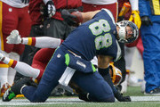 Tight end Jimmy Graham #88 of the Seattle Seahawks is tackled by cornerback Josh Norman #24 of the Washington Redskins at CenturyLink Field on November 5, 2017 in Seattle, Washington. Unnecessary roughness was call against Norman on the play.