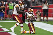 Running back Adrian Peterson #26 of the Washington Redskins reacts with teammate tight end Vernon Davis #85 after scoring a one-yard touchdown during the second quarter against the Arizona Cardinals at State Farm Stadium on September 9, 2018 in Glendale, Arizona.
