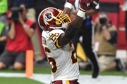Running back Adrian Peterson #26 of the Washington Redskins reacts after scoring a one-yard touchdown during the second quarter against the Arizona Cardinals at State Farm Stadium on September 9, 2018 in Glendale, Arizona.
