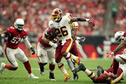 Running back Adrian Peterson #26 of the Washington Redskins runs during the first half against the Arizona Cardinals at State Farm Stadium on September 9, 2018 in Glendale, Arizona.