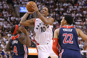 DeMar DeRozan #10 of the Toronto Raptors tries to get a shot off over Ty Lawson #4 of the Washington Wizards in Game Two of the Eastern Conference First Round in the 2018 NBA Play-offs at the Air Canada Centre on April 17, 2018 in Toronto, Ontario, Canada. The Raptors defeated the Wizards 130-119.