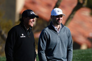 NFL quarterback Christian Ponder (R) talks with Phil Mickelson on the second hole during the pro-am for the the Waste Management Phoenix Open at TPC Scottsdale on February 3, 2016 in Scottsdale, Arizona.