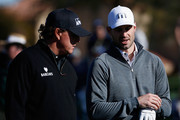 NFL quarterback Christian Ponder (R) talks with Phil Mickelson on the first green during the pro-am for the the Waste Management Phoenix Open at TPC Scottsdale on February 3, 2016 in Scottsdale, Arizona.