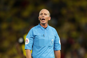 Referee Mike Dean in action during the Premier League match between Watford FC and Manchester United at Vicarage Road on September 15, 2018 in Watford, United Kingdom.