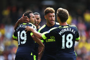 Santi Cazorla of Arsenal celebrates scoring his sides first goal with his team mates during the Premier League match between Watford and Arsenal at Vicarage Road on August 27, 2016 in Watford, England.