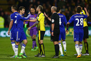 Referee Mike Dean speaks with Oscar of Chelsea during the Barclays Premier League match between Watford and Chelsea at Vicarage Road on February 3, 2016 in Watford, England.