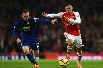 Wayne Rooney Alex Oxlade-Chamberlain Arsenal v Manchester United - Premier League