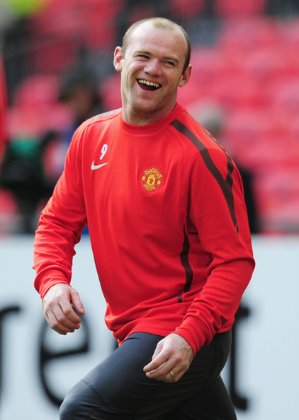Wayne Rooney Wayne Rooney of Manchetser United laughs during a Manchester United training session prior to the UEFA Champions League final versus Barcelona at Wembley Stadium on May 27, 2011 in London, England.