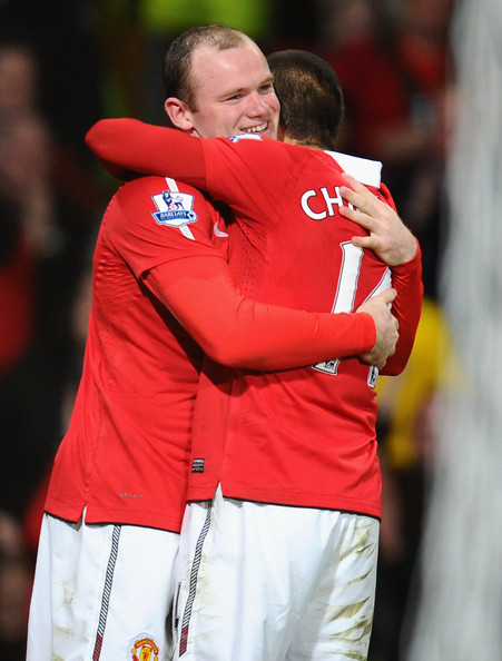 Wayne Rooney Wayne Rooney of Manchester United celebrates scoring his side's second gaol with teammate Javier Hernandez during the FA Cup sponsored by E.On Sixth Round match between Manchester United and Arsenal at Old Trafford on March 12, 2011 in Manchester, England.