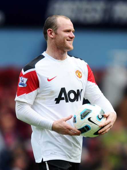 Wayne Rooney Wayne Rooney of Manchester United leaves the field with the match ball after his hat trick during the Barclays Premier League match between West Ham United and Manchester United at the Boleyn Ground on April 2, 2011 in London, England.