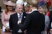 Prince Philip, Duke of Edinburgh talks to Prince Harry, Duke of Sussex as they leave after the wedding of Lady Gabriella Windsor to Thomas Kingston at St George's Chapel, Windsor Castle on May 18, 2019 in Windsor, England.