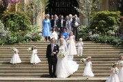 Newlyweds Mr Thomas Kingston and Lady Gabriella Windsor pose on the steps of the chapel with their bridesmaids, page boys and guests after their wedding at St George's Chapel on May 18, 2019 in Windsor, England.