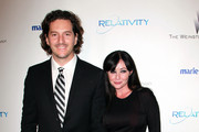 Actress Shannon Doherty (R) and photographer Kurt Iswarienko arrives at The Weinstein Company And Relativity Media's 2011 Golden Globe Awards Party held at The Beverly Hilton hotel on January 16, 2011 in Beverly Hills, California.