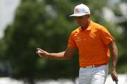 Rickie Fowler acknowledges the gallery after his par putt on the second green during the final round of the 2018 Wells Fargo Championship at Quail Hollow Club on May 6, 2018 in Charlotte, North Carolina.