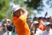 Rickie Fowler plays his tee shot on the first hole during the final round of the 2018 Wells Fargo Championship at Quail Hollow Club on May 6, 2018 in Charlotte, North Carolina.