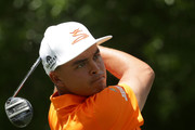 Rickie Fowler plays his tee shot on the second hole during the final round of the 2018 Wells Fargo Championship at Quail Hollow Club on May 6, 2018 in Charlotte, North Carolina.
