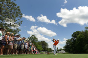 Rickie Fowler plays his tee shot on the eighth hole during the final round of the 2018 Wells Fargo Championship at Quail Hollow Club on May 6, 2018 in Charlotte, North Carolina.