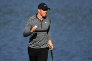 Rory McIlroy of Northern Ireland acknowledges the gallery following his par putt attempt on the 14th green during the first round of the 2018 Wells Fargo Championship at Quail Hollow Club on May 3, 2018 in Charlotte, North Carolina.