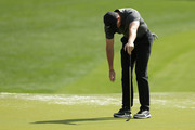 Rory McIlroy of Northern Ireland reacts following a putt attempt on the first green during the first round of the 2018 Wells Fargo Championship at Quail Hollow Club on May 3, 2018 in Charlotte, North Carolina.