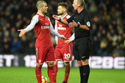 Jack Wilshere of Arsenal has a word with Referee Mike Dean during the Premier League match between West Bromwich Albion and Arsenal at The Hawthorns on December 31, 2017 in West Bromwich, England.