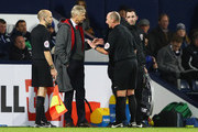 Arsene Wenger, Manager of Arsenal in discussion with referee Mike Dean during the Premier League match between West Bromwich Albion and Arsenal at The Hawthorns on December 31, 2017 in West Bromwich, England.