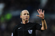 Referee Mike Dean makes a point during the Barclays Premier League match between West Bromwich Albion and Aston Villa at The Hawthorns on December 13, 2014 in West Bromwich, England.