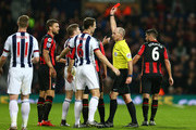 James McClean (3rd L) of West Bromwich Albion is shown a red card by referee Mike Dean after fouling Adam Smith of Bournemouth during the Barclays Premier League match between West Bromwich Albion and A.F.C. Bournemouth at The Hawthorns on December 19, 2015 in West Bromwich, England.