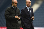 Referee Mike Dean (R) is seen on arrival at the stadium prior to the Barclays Premier League match between West Bromwich Albion and A.F.C. Bournemouth at The Hawthorns on December 19, 2015 in West Bromwich, England.