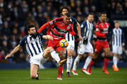 Gareth Barry of West Bromwich Albion and Collin Quaner of Huddersfield Town battle for the ball during the Premier League match between West Bromwich Albion and Huddersfield Town at The Hawthorns on February 24, 2018 in West Bromwich, England.