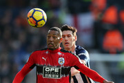 Rajiv van La Parra of Huddersfield Town is challenged by Gareth Barry of West Bromwich Albion during the Premier League match between West Bromwich Albion and Huddersfield Town at The Hawthorns on February 24, 2018 in West Bromwich, England.
